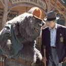 Big Al (left), longtime caretaker of Country Bear Hall, gives the lowdown to Reed Thimple (Christopher Walken, right), an evil banker determined to destroy the legendary venue in Walt Disney's The Country Bears - 2002