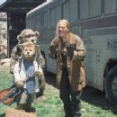 Beary (foreground, left) finds new friends in the Bears' manager, Henry (background left), and Roadie (M.C. Gainey, right) in Walt Disney's The Country Bears - 2002