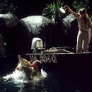 """Steve Irwin and Terri Irwin struggle by night to capture and relocate a 12-foot """"saltie"""" in MGM's The Crocodile Hunter: Collision Course - 2002"""