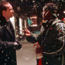 Nicolas Cage and Don Cheadle in Universal's The Family Man - 2000