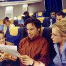 Reading about Lizzie's misadventures, her mom (Hallie Todd, right), dad (Robert Carradine, center) and annoying brother Matt (Jake Thomas, left) all fly off to Italy - 454 x 299