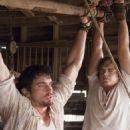 "(left to right) Matthew Bomer as ""Eric"" and Taylor Handley as ""Dean"" in New Line Cinema's Texas Chainsaw Massacre: The Beginning. Photo Credit: 2005 Van Redin/New Line Productions"
