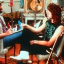 Filmmaker Marty DiBergi (Rob Reiner) talks with Nigel Tufnel (Christopher Guest) on the set of his definitive rockumentary in This Is Spinal Tap - 1984, re-released by MGM in 2000