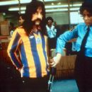 Harry Shearer as bass player Derek Smalls, going through airport security in This Is Spinal Tap - 1984, re-released by MGM in 2000