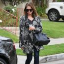 Ashley Benson stops to pose with some fans after having lunch at Lemonade in Los Angeles, California on January 24, 2014