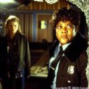 Reese (Loretta Devine, left), campus security guard at Alpine University, sizes up the latest in a series of 'accidents' that plagues the school's Hitchcock award competition and terrifies aspiring filmmaker Amy (Jennifer Morrison) in Columbia