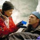 Trapped in a crevasse at 26,000 feet, where every breath is a frozen gasp for air and it takes a lifetime of effort simply to survive, Annie Garrett (Robin Tunney) tends to wounded climber and guide Tom McLaren (Nicholas Lea) in the Columbia Pictures pres - 400 x 267