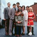From left to right: Emil Marwa, Raji James, Chris Bisson, Archie Panjabi, Jordan Routledge (front), Ruth Jones, Jimi Mistry and Emma Rydal in Miramax's East Is East - 2000