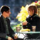 Paul Tannek (Jason Biggs) meets a kindred spirit in down-on-her-luck Dora Diamond (Mena Suvari) in Columbia's Loser - 2000