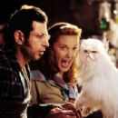 Jeff Goldblum and Elizabeth Perkins are captured by Tinkles (Sean Hayes) in Warner Brothers' Cats and Dogs - 2001