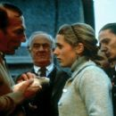 Hubert (Pete Postlethwaite) shows his rat to Uncle Matt (Frank Kelly), Marietta (Kerry Condon) and the others in Universal Focus' Rat - 2001