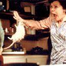 Conchita (Imelda Staunton) is bitten by her husband in the form of a white rat in Universal Focus' Rat - 2001