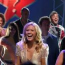 Conniving steel magnolia Sally (Mandy Moore), surrounded by a cast of hopefuls, makes an appearance as a contestant on the reality show American Dreamz.