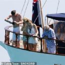 Queen's Roger Taylor uses a pole and shoots an AIRGUN at jellyfish whilst on a boat ride with his wife and children during sun-soaked holiday in Spain, 31 May 2019 - 306 x 307