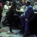 Jack Fate (Bob Dylan) and Uncle Sweetheart (John Goodman) meet in the dive bar where Fate performs for the first time since being released from prison.