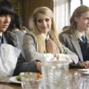 (L to R) Josie (LINZEY COCKER), Poppy (EMMA ROBERTS) and Kate (KIMBERLY NIXON) in a comedy about a pampered American princess who meets her match in a school of British girls who won't tolerate her spoiled ways—Wild Child. Credit: Giles Keyte - 454 x 302