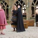 (L-r) IMELDA STAUNTON as Dolores Umbridge, EMMA THOMPSON as Sybill Trelawney, MAGGIE SMITH as Minerva McGonagall and DAVID BRADLEY as Argus Filch in Warner Bros. Pictures' fantasy 'Harry Potter and the Order of the Phoenix.' Photo by Murray Cl
