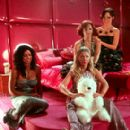 Mega Records CEO Fiona (Parker Posey, right) signs The Pussycats (Rosario Dawson, Rachael Leigh Cook and Tara Reid) to her label in Universal's Josie and the Pussycats - 2001