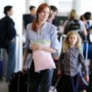 Marcia Cross and family seen at LAX - 400 x 600