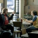 Veteran rock writer Lester Bangs (Philip Seymour Hoffman, left) gives advice to neophyte reporter William Miller (Patrick Fugit) about being a rock journalist in Dreamworks' Almost Famous - 2000