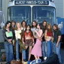 Posing in front of the Stillwater tour bus are Dick Roswell (Noah Taylor), William Miller (Patrick Fugit), Penny Lane (Kate Hudson), Russell Hammond (Billy Crudup), Sapphire (Fairuza Balk), Jeff Bebe (Jason Lee), Polexia (Anna Paquin), Larry Fellows (Mark