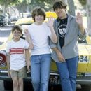 (Left to right) Michael Angarano, who plays Young William Miller, and Patrick Fugit, who stars as the 15-year-old William Miller, pose with writer/director/producer Cameron Crowe on the set of his semi-autobiographical film, Dreamworks' Almost Famous