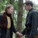 "Mia Wasikowska as ""Chaya"" and Jamie Bell as ""Assael"" star in DEFIANCE, a Paramount Vantage release. Photo by Karen Ballard. (c) 2007 by PARAMOUNT VANTAGE, a Division of PARAMOUNT PICTURES.  All Rights Reserved."