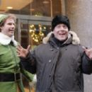 Will Ferrell (left) and Director Jon Favreau have some fun on the set of New Line Cinema's upcoming family comedy, Elf.