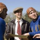 Bakes (MALCOLM GOODWIN), Bulldogs team captain Dodge Connolly (GEORGE CLOONEY) and Zoom (NICK PAONESSA) discuss strategy. - 454 x 303