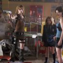 Milla Jovovich (left), Sophie Vavasseur (center) and Sienna Guillory (right) star in Alexander Witt's Resident Evil: Apocalypse, a Sony Pictures Entertainment release.
