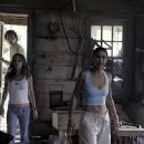 Eliza Dushku and Emmanuelle Chriqui in 20th Century Fox's Wrong Turn - 2003