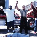 The ref declares gang-bangers Shay Roundtree (LIL' MONSTER) and Corey Parker Robinson (CRAZY DEE) the winners of the boxing match at Florence and Normandie in 'The L.A. Riot Spectacular.' Directed by Marc Klasfeld  -  Copyright ©2005 - 2006 - 350 x 238