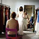 Nicole (Julianne Nicholson) is fitted for wedding gown as her best friend Tess (Chelsea Altman) critically consults in a scene from Jeff Lipsky's romantic drama Flannel Pajamas.