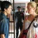 Samrit Machielsen as Than and Toni Collette as Kathy Graham in Tsunami: The Aftermath.