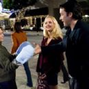 "(L-r) DIANE LANE, JORDANA SPIRO and JOHN CUSACK in Warner Bros. Pictures' romantic comedy ""Must Love Dogs."""