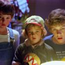 Elliott (Henry Thomas) introduces his sister Gertie (Drew Barrymore) and brother Michael (Robert Macnaughton) to his new friend in Universal's E.T. The Extra-Terrestrial - 1982 - 454 x 294
