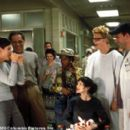 (Clockwise from left, foreground) Gwen (Sandra Bullock), Daniel (Reni Santoni), Roshanda (Marianne Jean-Baptiste), Gerhardt (Alan Tudyk) and Oliver (Mike O'Malley) give Andrea (Azura Skye) a humorous sendoff from rehab in the Columbia Pictures present