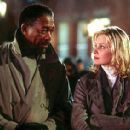 Morgan Freeman as Alex Cross and Monica Potter as Jezzie Flannigan in Paramount's Along Came A Spider - 2001
