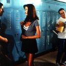 Jason Biggs is shocked when gorgeous exchange student Shannon Elizabeth asks for help with her studies, and Jim's friends Chris Klein and Thomas Ian Nicholas watch it happen in Universal's American Pie - 1999