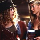 Natasha Lyonne gives Tara Reid advice about men in Universal's American Pie - 1999