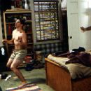 Jason Biggs dances towards manhood without knowing that Eugene Levy is looking on in Universal's American Pie - 1999