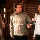 Embeth Davidtz, with Robin Williams (center) in Touchstone's Bicentennial Man - 12/99