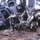 Ty Burrell (left) as Wilkinson and Jeremy Piven (on stretcher) as Wolcott in Columbia's Black Hawk Down - 2001