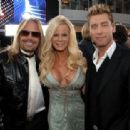Musician Vince Neil, wife Lia Gerardini and singer Lance Bass arrive at the 2008 American Music Awards held at Nokia Theatre L.A. LIVE on November 23, 2008 in Los Angeles, California.