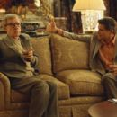 Director Val Waxman (Woody Allen, left) has an uncomfortable meeting about the progress of his comeback film with studio head Hal (Treat Williams) in Dreamworks' Hollywood Ending - 2002