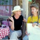 Director Dennie Gordon (left) and star David Spade discuss a scene during the filming of the Columbia Pictures presentation, Joe Dirt - 2001 - 400 x 267