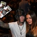 Guitarist Dj Ashba (L) of Guns N Roses and his wife, model Nathalia Henao, attend the UFC 175 event at the Mandalay Bay Events Center on July 5, 2014 in Las Vegas, Nevada - 454 x 335