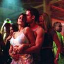Brittany (Susan Ward) and Adrien (Lori Heuring) dance with a dude in Warner Brothers' The In Crowd - 2000