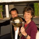 Mick Jagger poses with the ICC Cricket World Cup trophy on October 23, 2014 in Adelaide, Australia