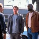 When legendary car thief Randall 'Memphis' Raines (Nicolas Cage, left) returns to town, he's immediately under suspicion by Detective Drycoff (Timothy Olyphant, center) and Detective Castlebeck (Timothy Olyphant, , right), in Touchstone's